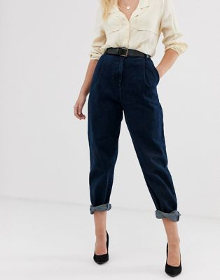 ASOS DESIGN tapered jeans with curved seams and belt in indigo wash