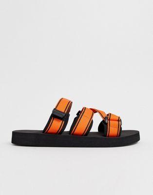 ASOS DESIGN tech sandals in black with orange tape straps