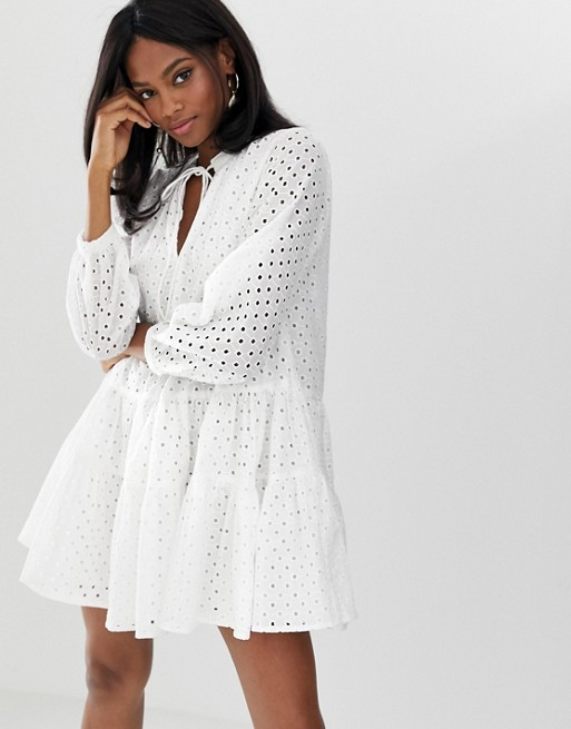 ASOS DESIGN tiered trapeze mini dress in broderie