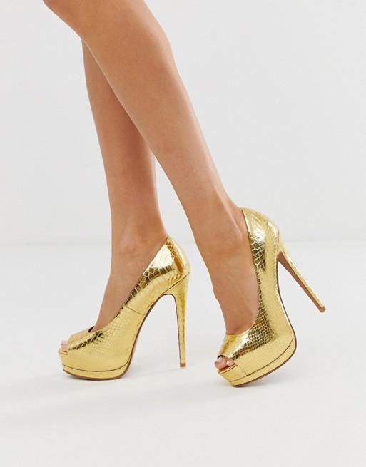 Bild 1 von ASOS DESIGN – Verspielte High-Heels mit Plateausohle und goldenem Schlangedruck