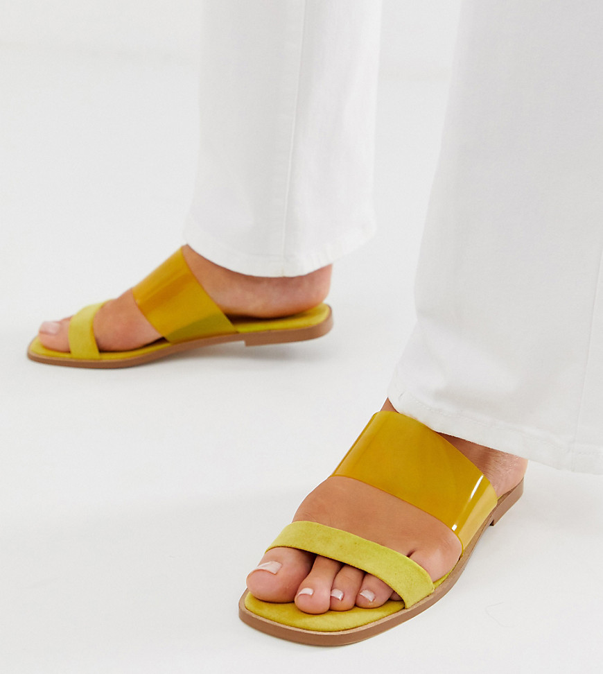 Sandals by ASOS DESIGN Sweet looks from the ground up Slip-on style Clear strap Open toe Flat sole Wide fit Same length, just wider