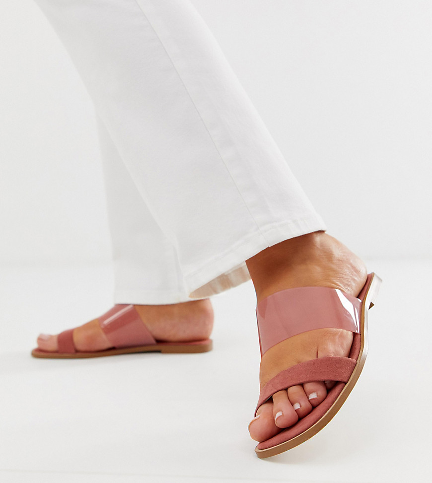 Sandals by ASOS DESIGN For that vacation you haven\\\'t booked yet Slip-on style Clear strap Open toe Flat sole Wide-fit style Designed for wider feet Cuz we know one size doesn\\\'t fit all