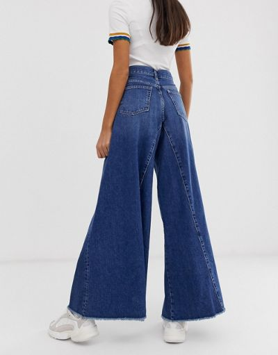 ASOS DESIGN wide leg jeans with inverted godet inserts in dark stone wash