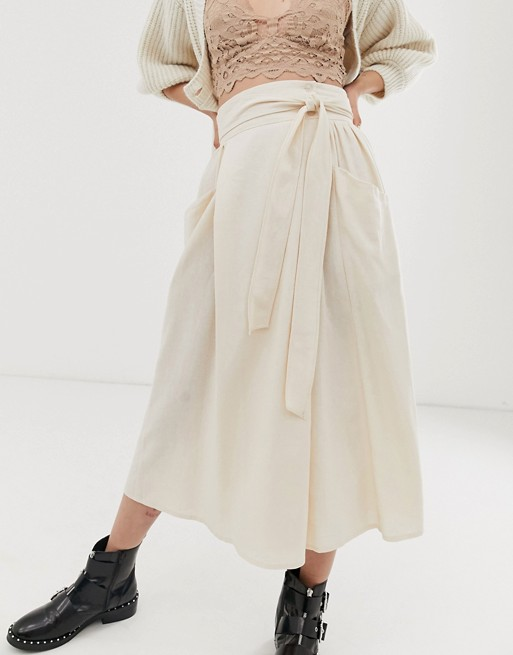 ASOS DESIGN wrap midi skirt with tie side and pockets