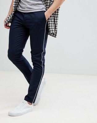 ASOS – Enge Hose in Marineblau mit weißen Zierstreifen