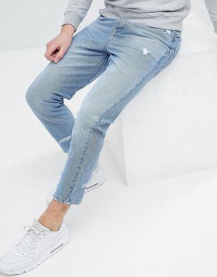 ASOS - Jeans blu lavaggio chiaro con abrasioni e cuciture irregolari