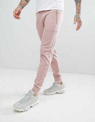 ASOS - Pantalon de jogging ajusté avec fermetures éclair - Rose
