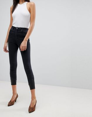 ASOS RIDLEY High Waist Skinny Jeans in Washed Black with Leather Look Western Hem Detail