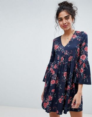 Image 1 of ASOS Smock Dress With V Neck and Trumpet Sleeve In Rose Print