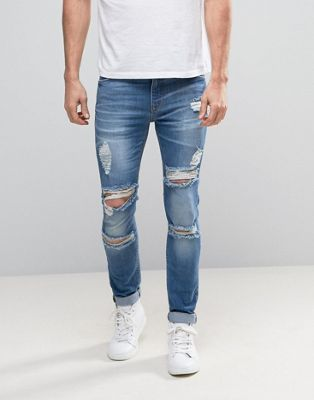 ASOS Super Skinny Jeans With Mega Rips In Mid Blue