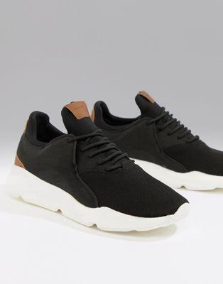 Bershka – Schwarze Sneaker mit braunem Design und dicker Sohle