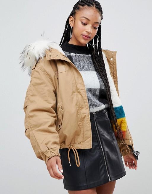 Image 1 of Bershka short parka with faux fur hood in khaki brown