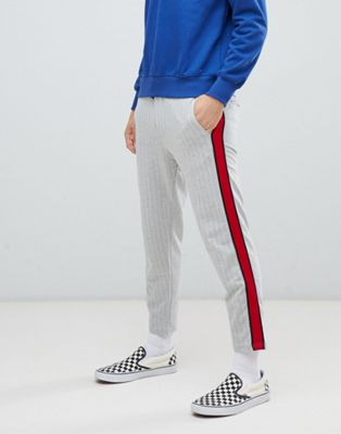 Image 1 of Bershka striped joggers in gray with red side stripe