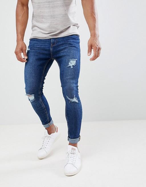 1f064a959c771 Bershka Super Skinny Jeans With Rips In Dark Blue