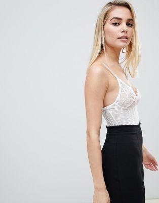 Body blanco con aros y encaje transparente por toda la prenda de Club L