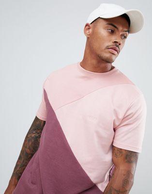 Image 1 of boohooMAN drop shoulder t-shirt in tonal pink colour block