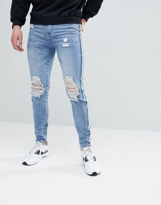 boohooMAN Raw Seam Skinny Jeans With Zip Hem In Blue Wash