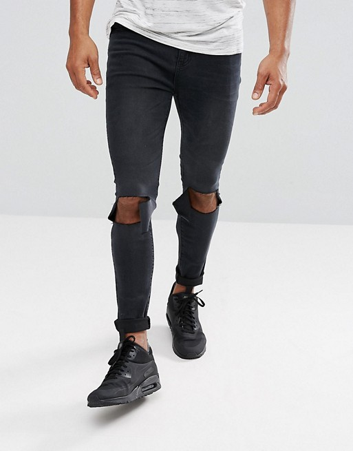 00ad17fc3d1d boohooMAN Super Skinny Jeans With Knee Rips In Black Wash | ASOS