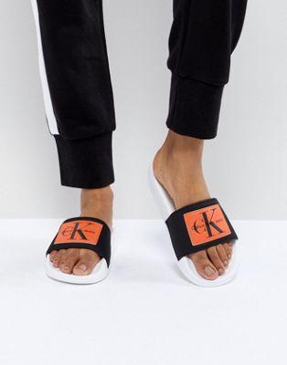 Calvin Klein Chloe Black and Orange Sliders