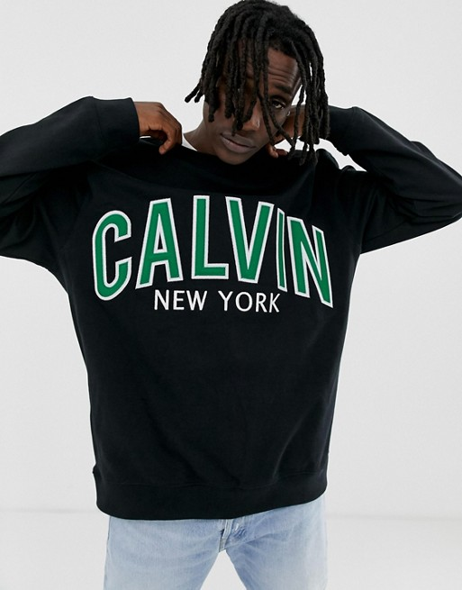 Image 1 of Calvin Klein Jeans large varsity logo crew neck sweatshirt in black