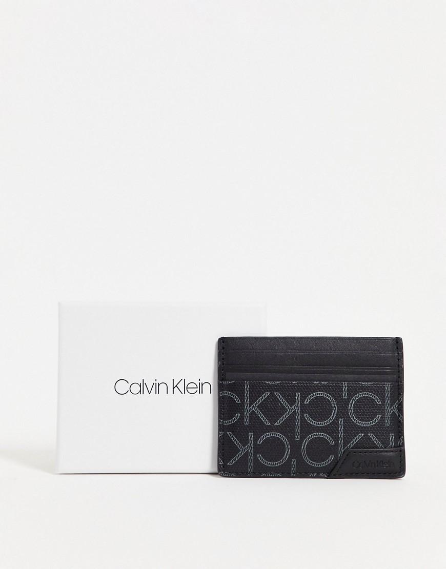 Calvin Klein - Kortholder i sort læder med monogram-print