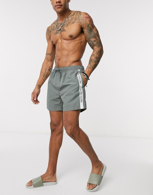 Calvin Klein logo tape swim shorts in grey