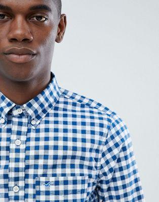 Camisa de popelina de cuadros vichy en azul con botones y logo de gaviota de Hollister