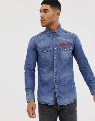 Camisa vaquera azul con bordados de Replay