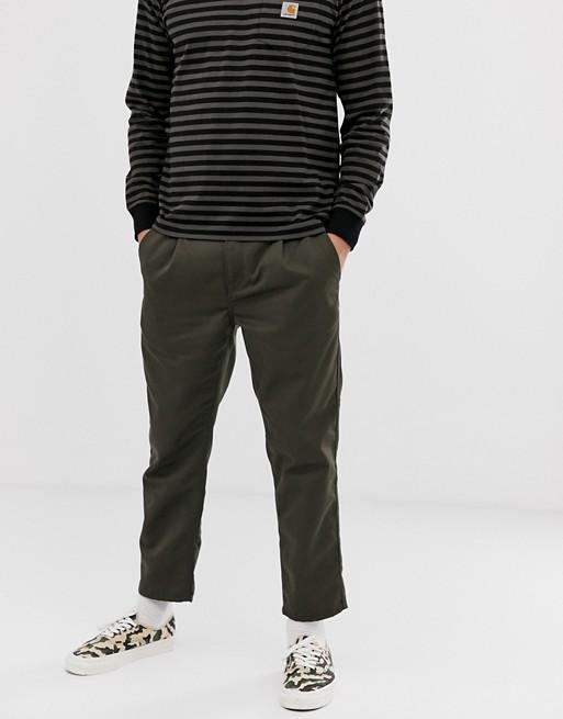 Carhartt WIP –Abott –Ciemnozielone spodnie o krótszym kroju