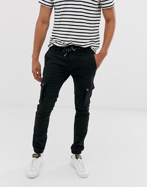 Celio cargo trouser with cuffed hem in black