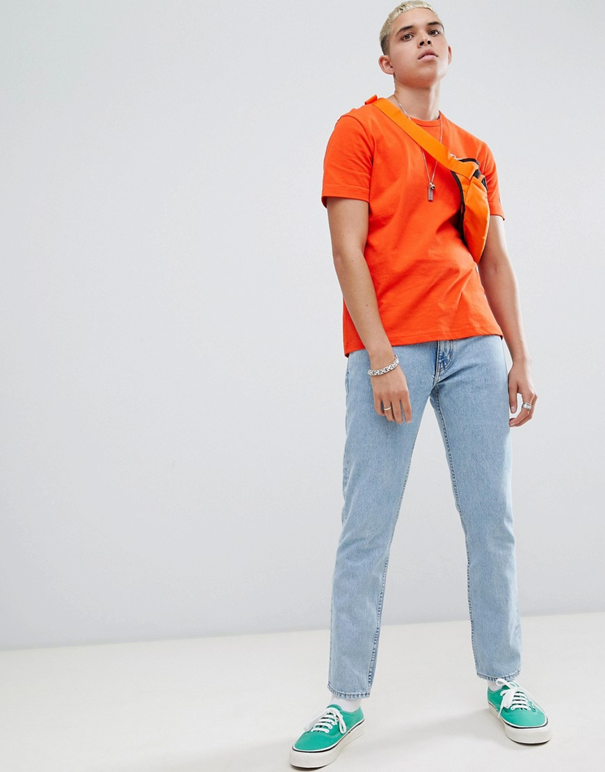 Champion T Shirt With Small Script Logo In Orange by Champion