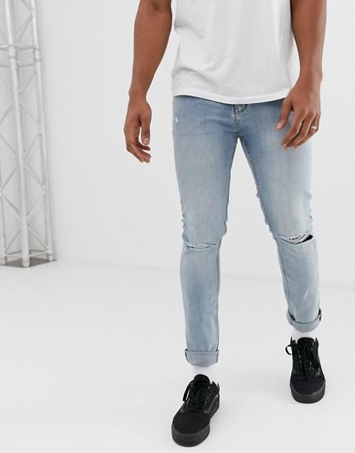 Cheap Monday – Enge Jeans mit Knierissen