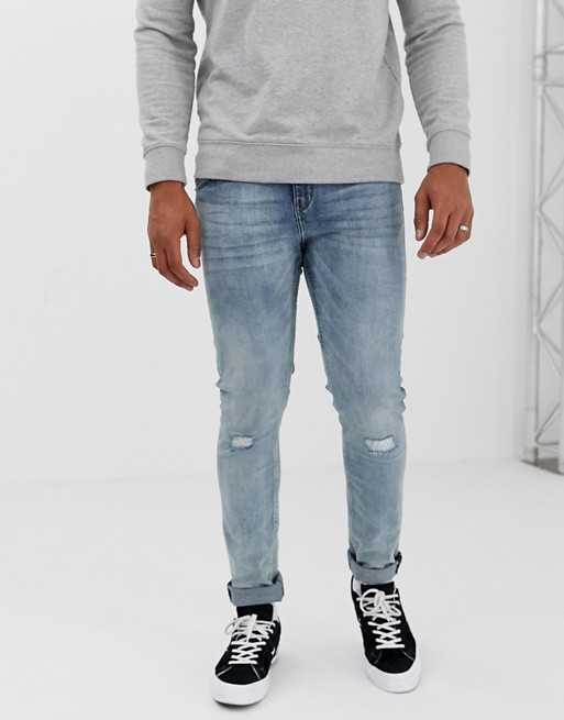 Cheap Monday tight skinny jeans with ripped knees