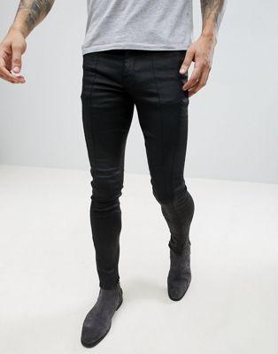 Черные джинсы скинни со вставками ASOS DESIGN