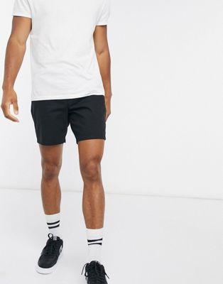 Черные облегающие шорты чиносы ASOS DESIGN