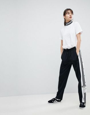 Черные спортивные штаны с кнопками по бокам adidas Originals adicolor