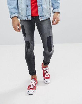 Черные выбеленные супероблегающие джинсы с рваной отделкой ASOS