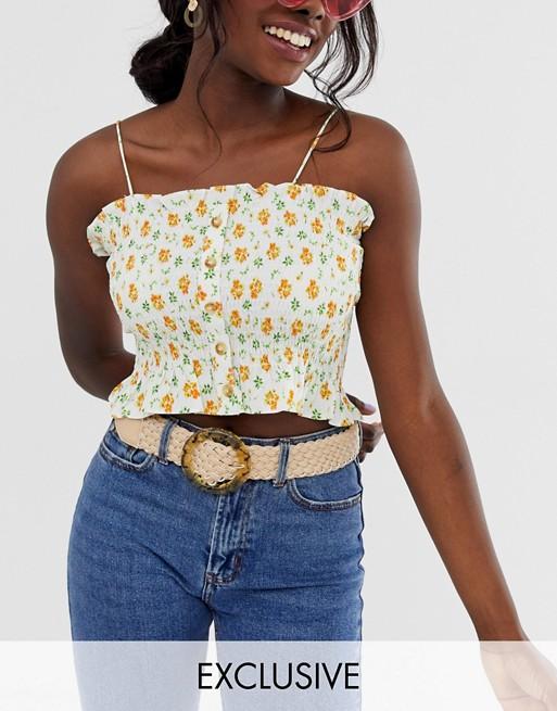 Imagen 1 de Cinturón tejido en color crema con hebilla circular de efecto carey exclusivo de Glamorous