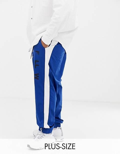 COLLUSION Plus – Blaue Jogginghose aus Webstoff mit Seitenstreifen