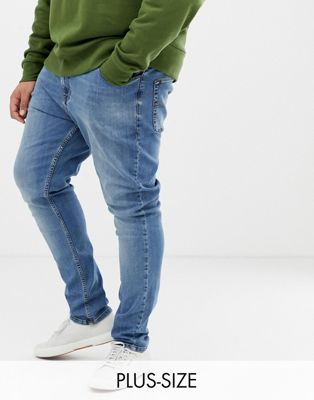 COLLUSION Plus skinny jeans in blue mid wash
