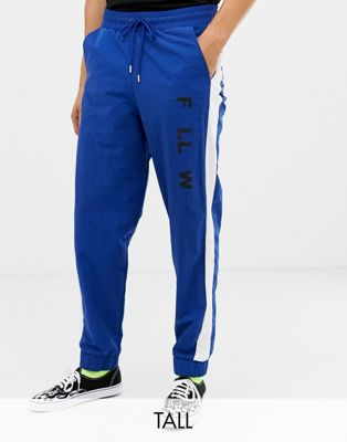 COLLUSION Tall - Pantalon de jogging tissé avec bande sur le côté - Bleu