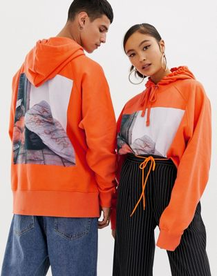 COLLUSION Unisex x Rene Matic oversized printed hoodie in orange
