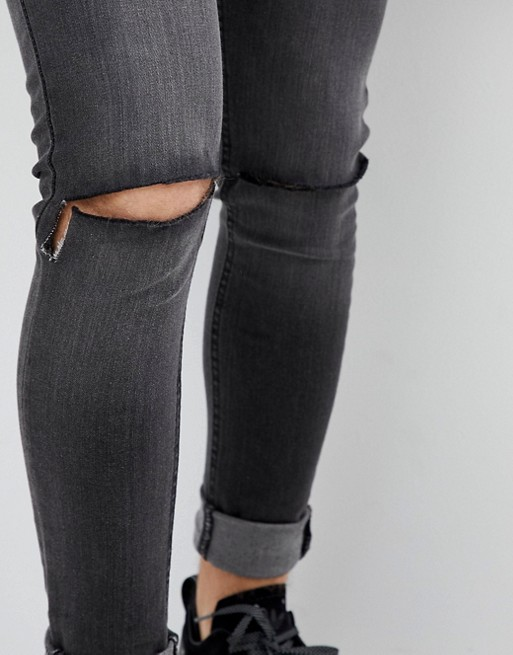 Criminal Damage Skinny Jeans in Show Wash Ripped
