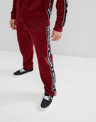 DC Shoes - Joggingbroek met logorand in bordeaurood