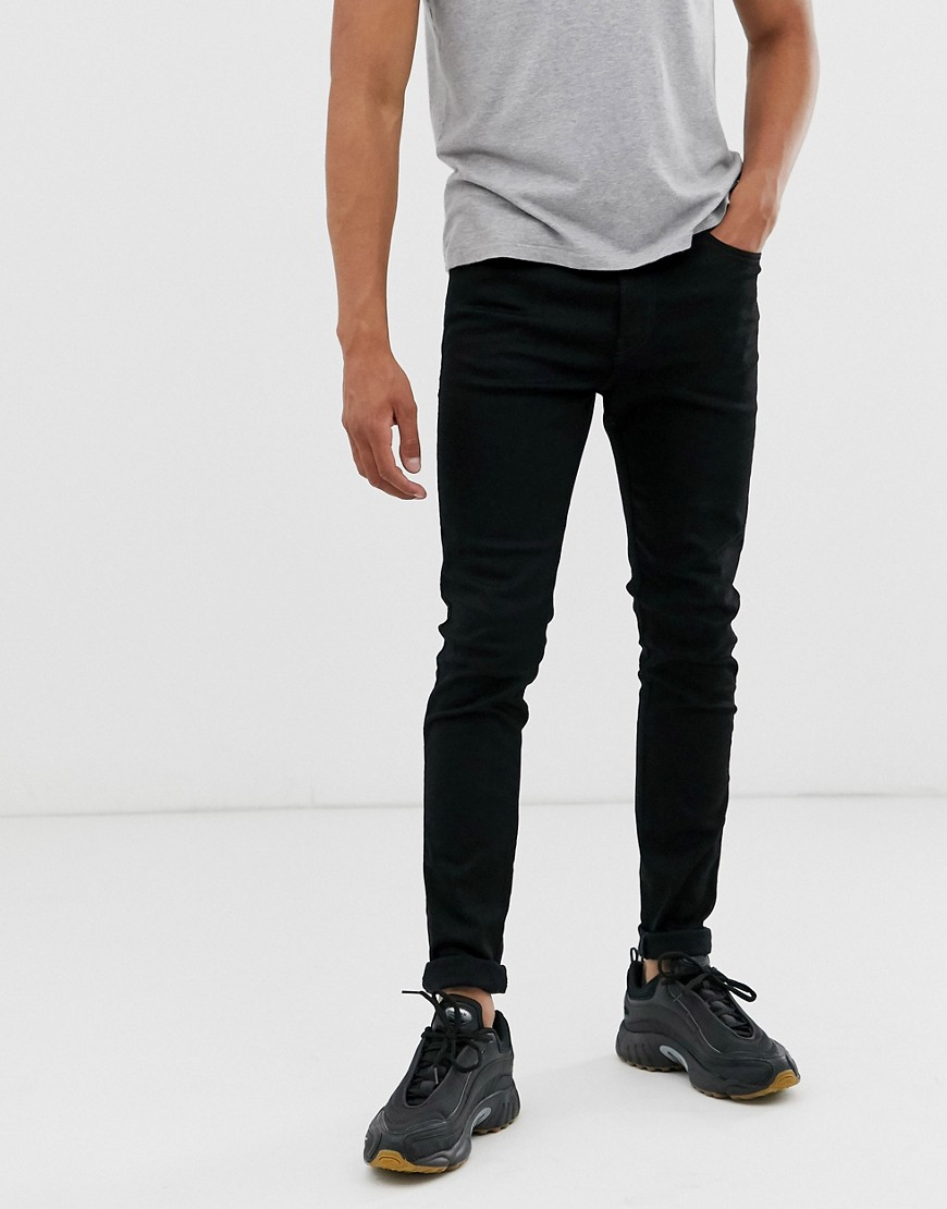 Jeans by Diesel For today, tomorrow and every day after Regular rise Concealed fly Functional pockets Branded patch to reverse Super-skinny fit Cut very closely from hips to hem