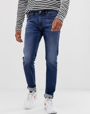 Diesel Thommer – Mellanblå slim jeans med stretch 082AZ