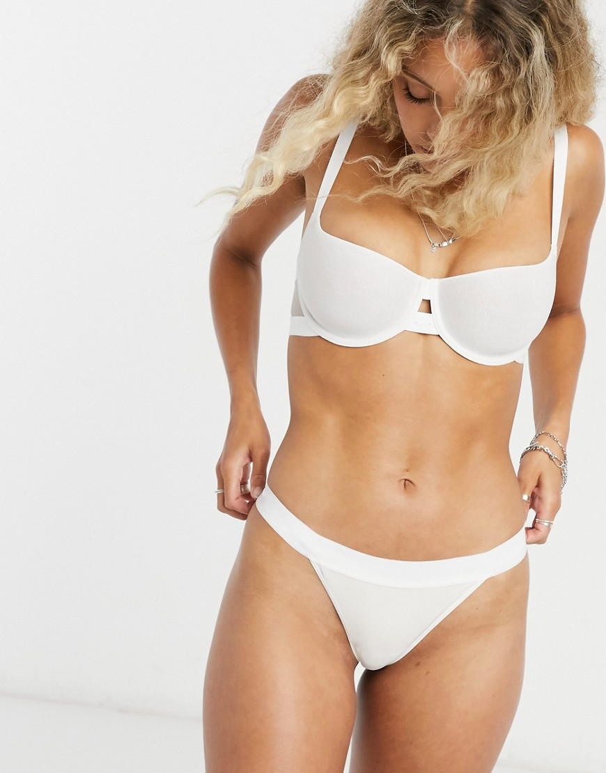 Bra by DKNY Cute and comfy Moulded cups Underwire support Cut-out detail Adjustable straps Hook-and-eye fastening