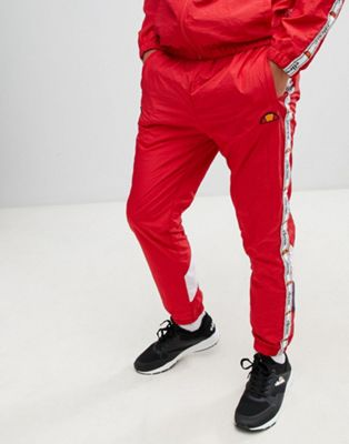 Image 1 of ellesse Avico shell suit track sweatpants with taping in red