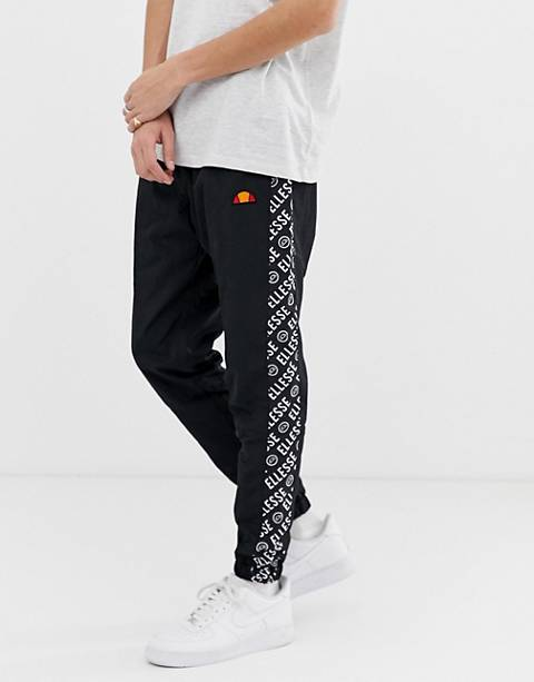 ellesse Fele co-ord track joggers with repeat logo side stripe in black
