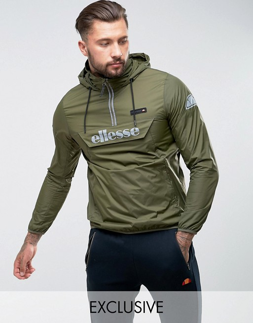 Image 1 of ellesse Overhead Jacket With Reflective Logo In Green